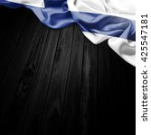 flag of finland on dark wood... | Shutterstock . vector #425547181