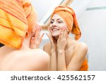 attractive woman wrapped in... | Shutterstock . vector #425562157