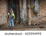 editorial use. children in... | Shutterstock . vector #425594995