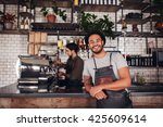 coffee shop worker smiling to... | Shutterstock . vector #425609614