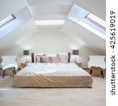 Small photo of Bright attic bedroom in the fashionable apartment