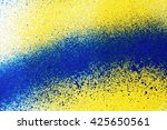 A Spray Of Blue Yellow  Paint...