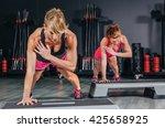 women couple training over... | Shutterstock . vector #425658925