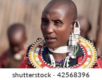 TANZANIA - AUGUST 18: Masai woman with their ornaments, women shave their heads differ from men only by their ornaments, August 18, 2007 in Ngorongoro, Tanzania - stock photo