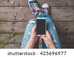 young woman using smart phone | Shutterstock . vector #425696977