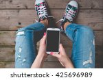 young woman using smart phone | Shutterstock . vector #425696989
