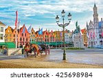 horse carriages on grote markt... | Shutterstock . vector #425698984