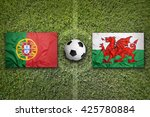 portugal vs. wales flags on a...   Shutterstock . vector #425780884