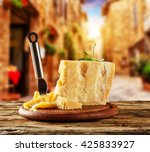 parmesan cheese on cutting... | Shutterstock . vector #425833927