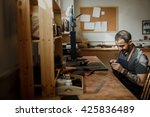 master a man in an apron sewing ... | Shutterstock . vector #425836489