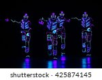 Dancers In Led Suits On Dark...