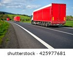three red trucks departing on... | Shutterstock . vector #425977681