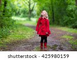 little girl playing in rainy... | Shutterstock . vector #425980159