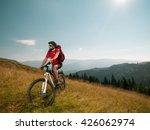 mountain biker on a meadow ... | Shutterstock . vector #426062974