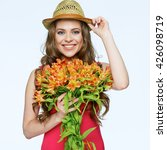 Smiling Woman With Bouquet...