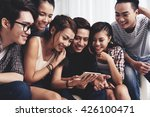 laughing friends watching old... | Shutterstock . vector #426100471