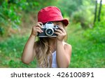 Child With Camera. Little Girl...