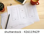 designer desk with ui wireframe ...