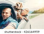 Stock photo father with son and dog look from the car window 426164959