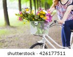 woman holding a vintage bicycle ... | Shutterstock . vector #426177511