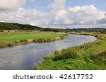 River Running Through A Valley