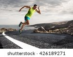 Male Runner Sprinting During...