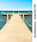 pier in heavenly blue place  | Shutterstock . vector #426192709
