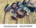 different sunglasses on wooden... | Shutterstock . vector #426195004