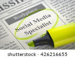 Stock photo social media specialist newspaper with the small advertising circled with a yellow marker 426216655