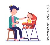 Mother feeding her baby child sitting on kids eating chair. Holding hands with spoon going to mouth. Modern flat style vector illustration cartoon clipart.