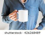 Hand Holding A White Coffee Cu...
