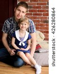 dad sits with her daughter in... | Shutterstock . vector #426280864