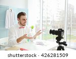 young male blogger recording... | Shutterstock . vector #426281509