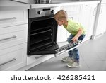 little child playing with... | Shutterstock . vector #426285421