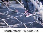 children climbing in a rope... | Shutterstock . vector #426335815