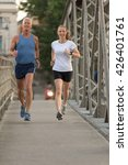 healthy mature couple jogging... | Shutterstock . vector #426401761