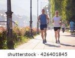 healthy mature couple jogging... | Shutterstock . vector #426401845