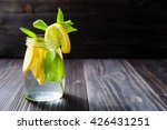 glass of lemonade with lemons... | Shutterstock . vector #426431251