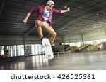 Boy Skateboarding Jump...