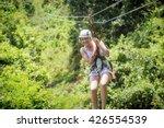 beautiful woman riding a zip...   Shutterstock . vector #426554539