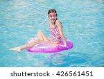 beautiful young girl playing in ... | Shutterstock . vector #426561451