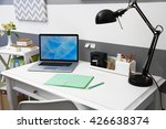 stylish workplace with laptop... | Shutterstock . vector #426638374