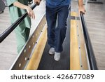 senior man walking with support ... | Shutterstock . vector #426677089