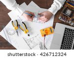 male hands drawing electrical... | Shutterstock . vector #426712324