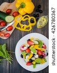 greek salad on wooden... | Shutterstock . vector #426780367