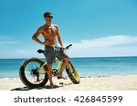 Fitness Male Model With Bike...