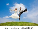 groom and bride jumping against ... | Shutterstock . vector #42690955