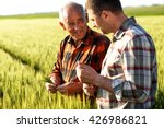 two farmers in a field... | Shutterstock . vector #426986821