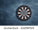 Small photo of Target aim, symbol of goal ,The game of darts target on wall