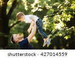 father and her child enjoy the... | Shutterstock . vector #427014559